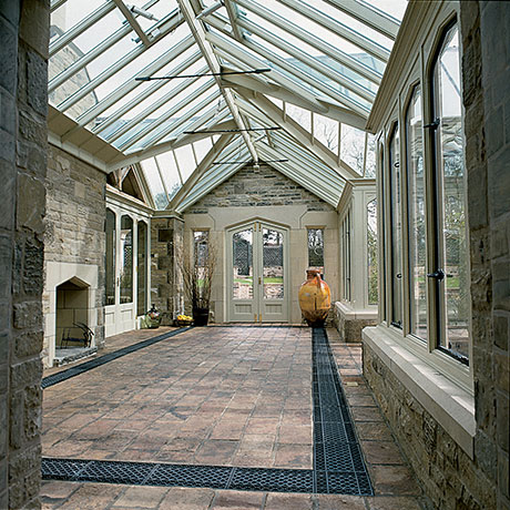 Traditional floor grilles in a stone floor.