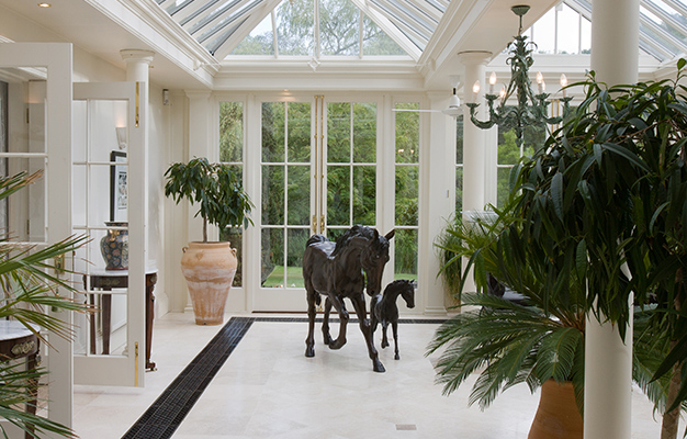 A more modern orangery with floor grilles providing heating.