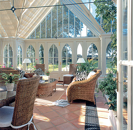 A traditional conservatory being used as a plant room, heated with underfloor heating.